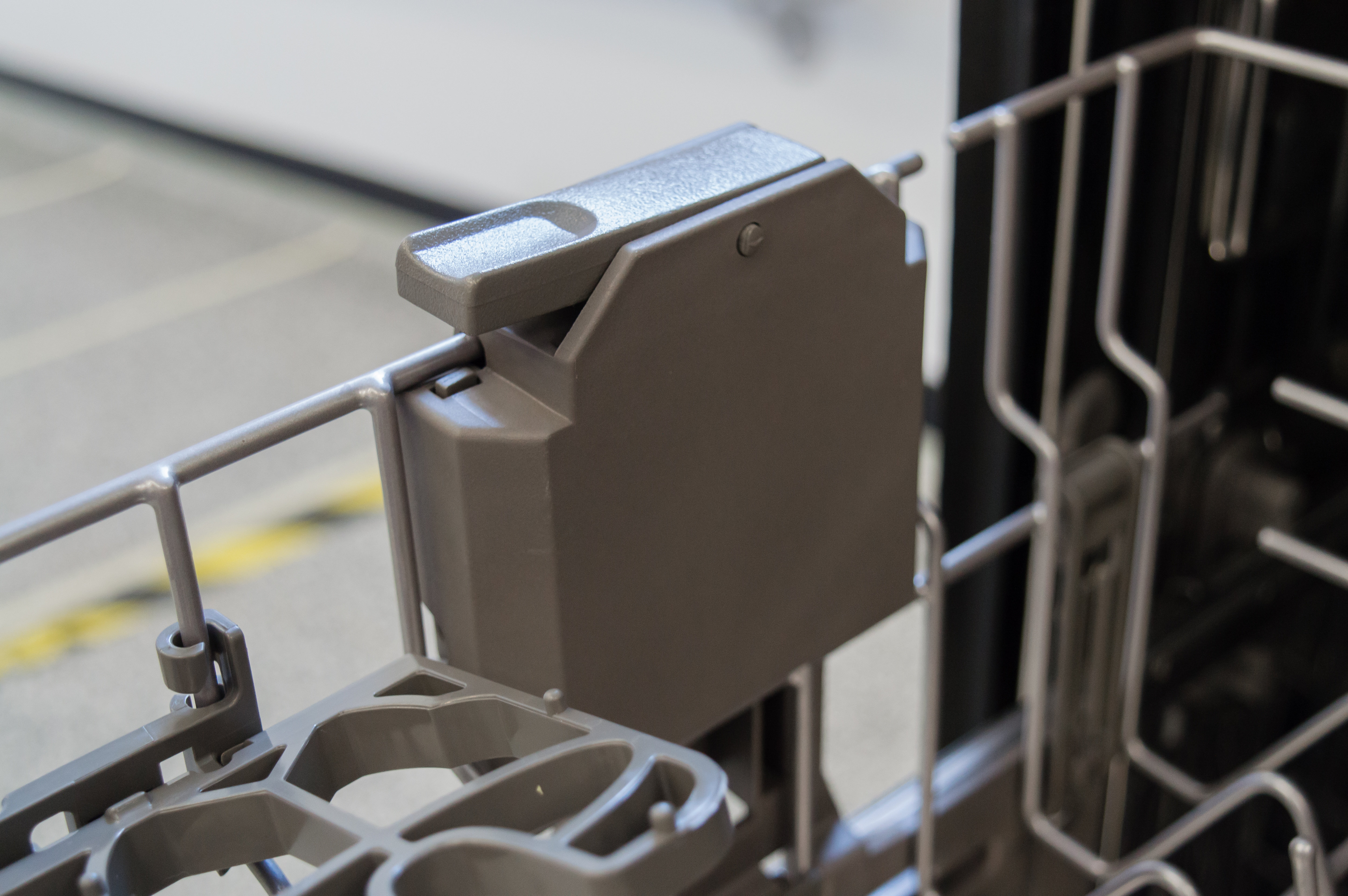 A lever used to adjust the upper rack's height