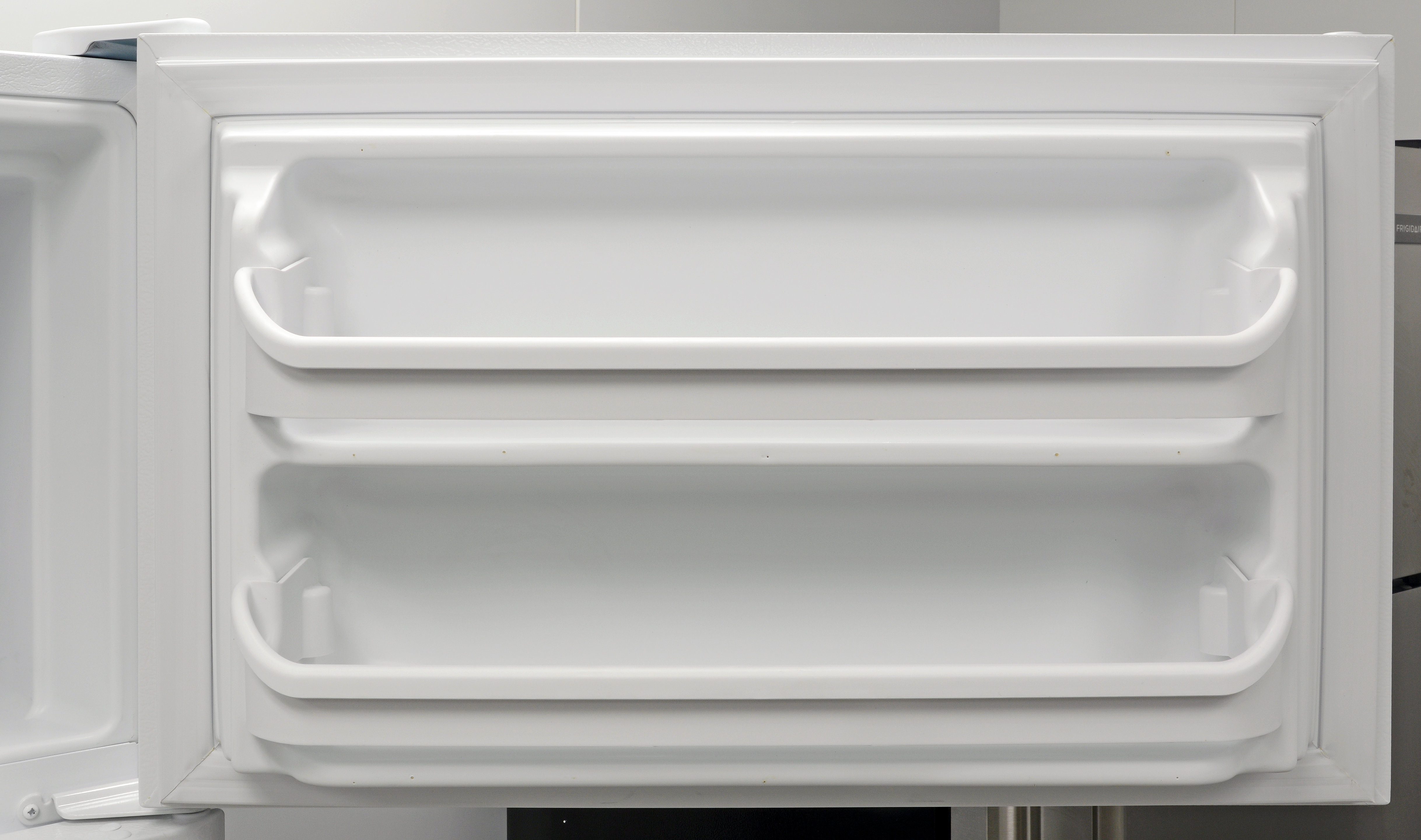 A pair of door shelves provides some extra storage for the Frigidaire FFTR1814QW's freezer.