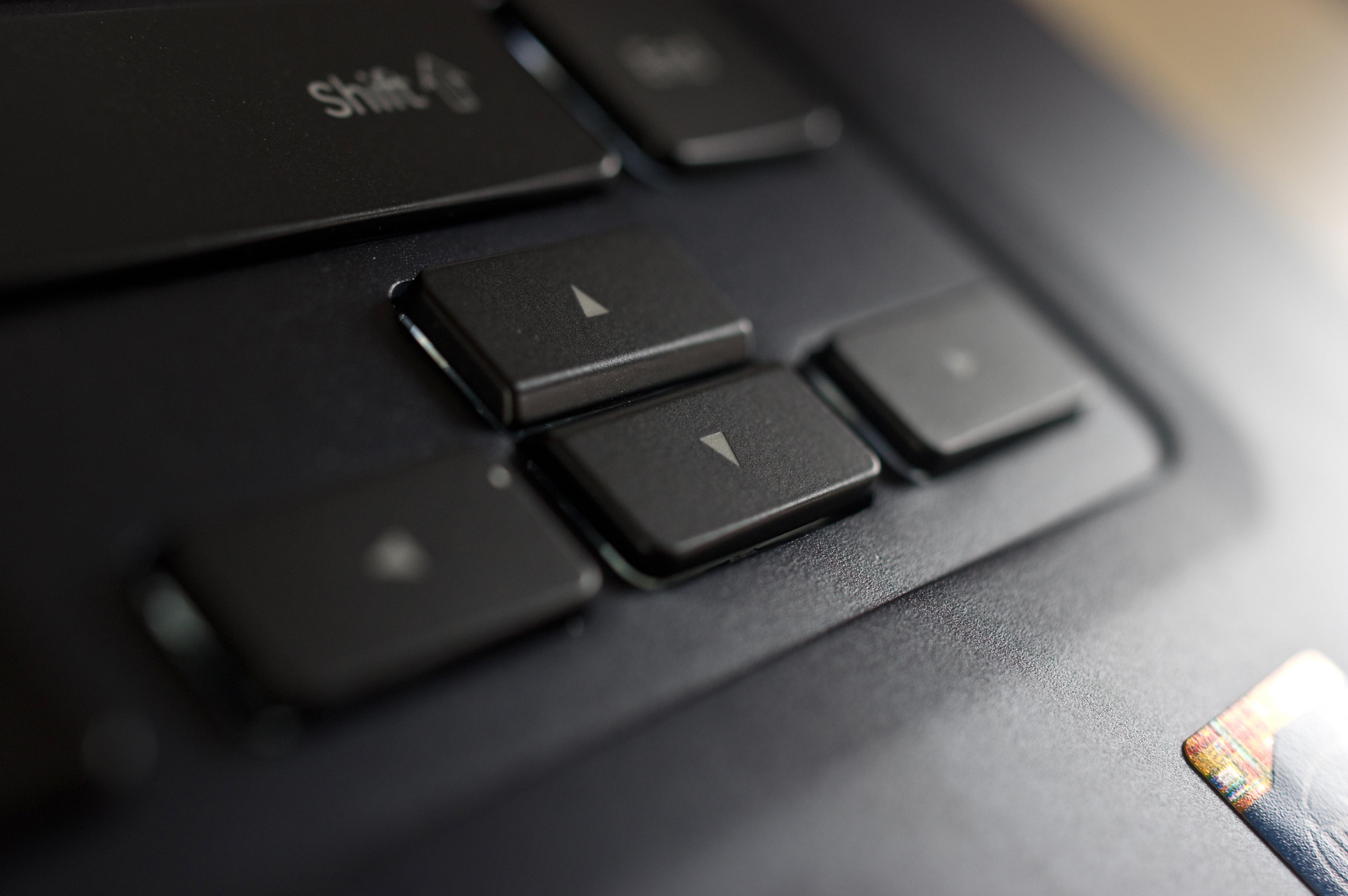 A photograph of the Samsung ATIV Book 9 2014 Edition's arrow keys.