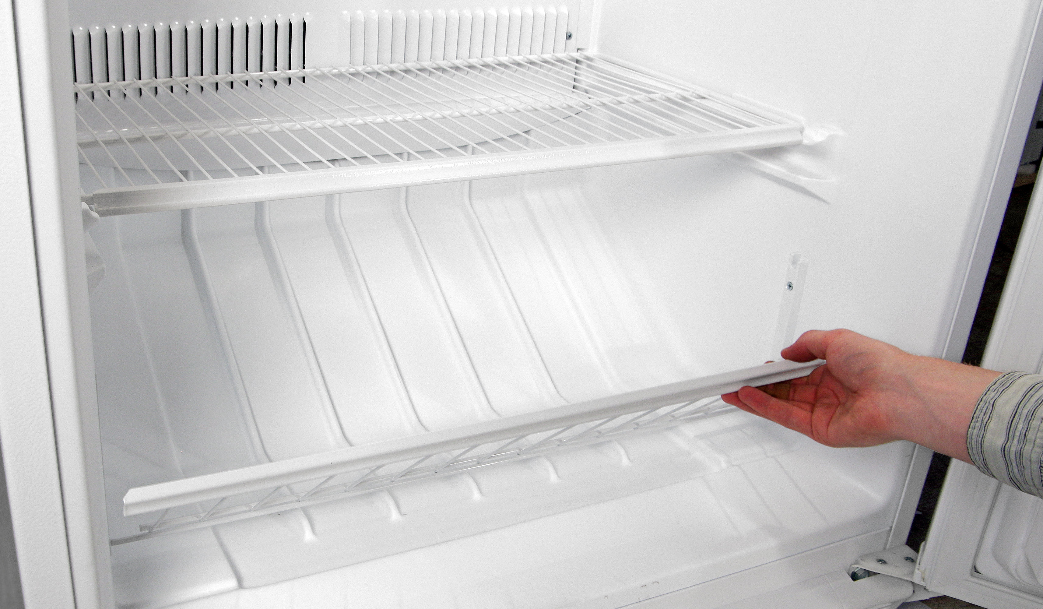 The Whirlpool EV160NZTQ's lower compartment is built into the bottom of the freezer with a gate-like barrier to keep the food in.