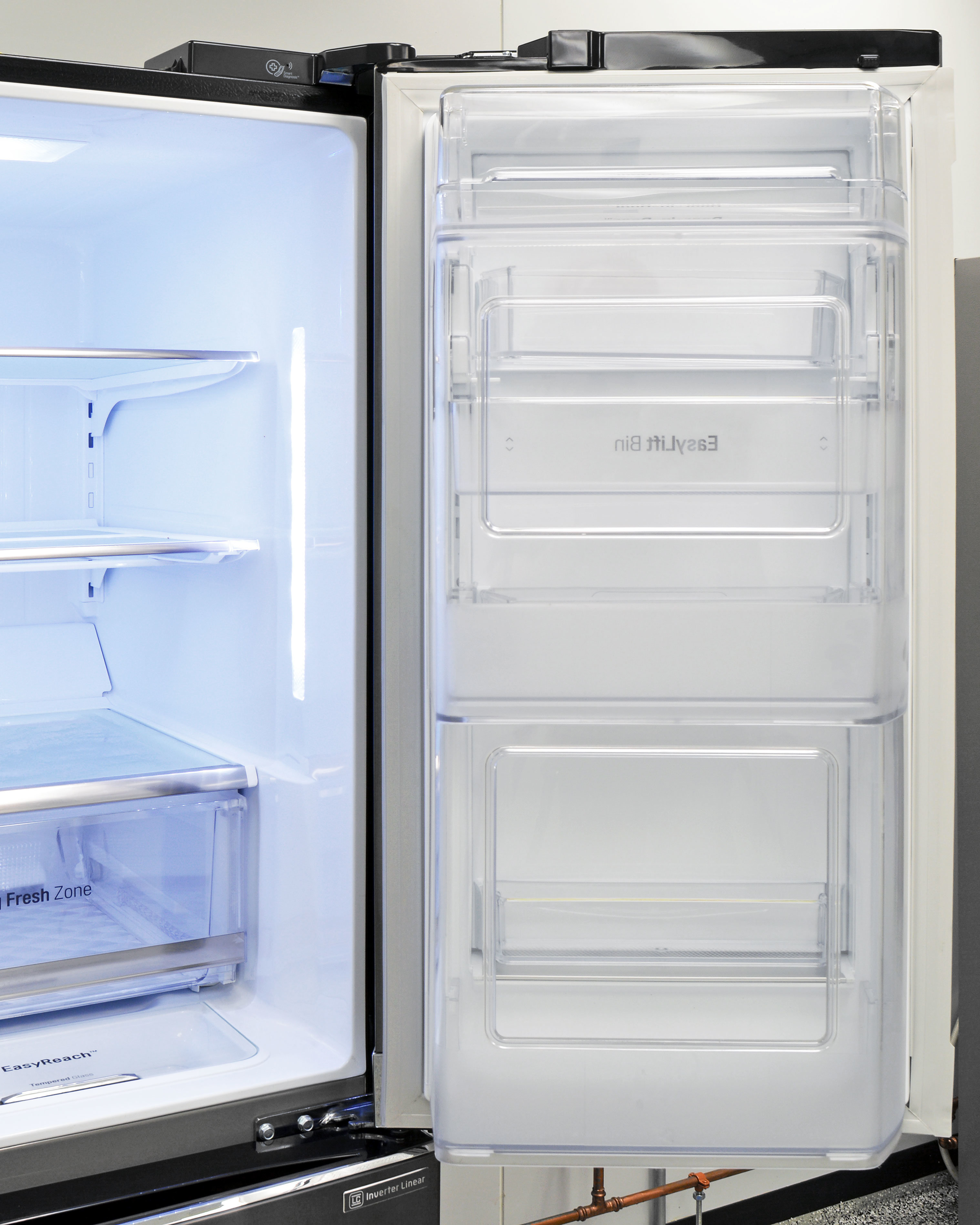 Many of the LG LPXS30866D's largest door shelves aren't easily accessible when the full door is open due to the fixed plastic barrier.