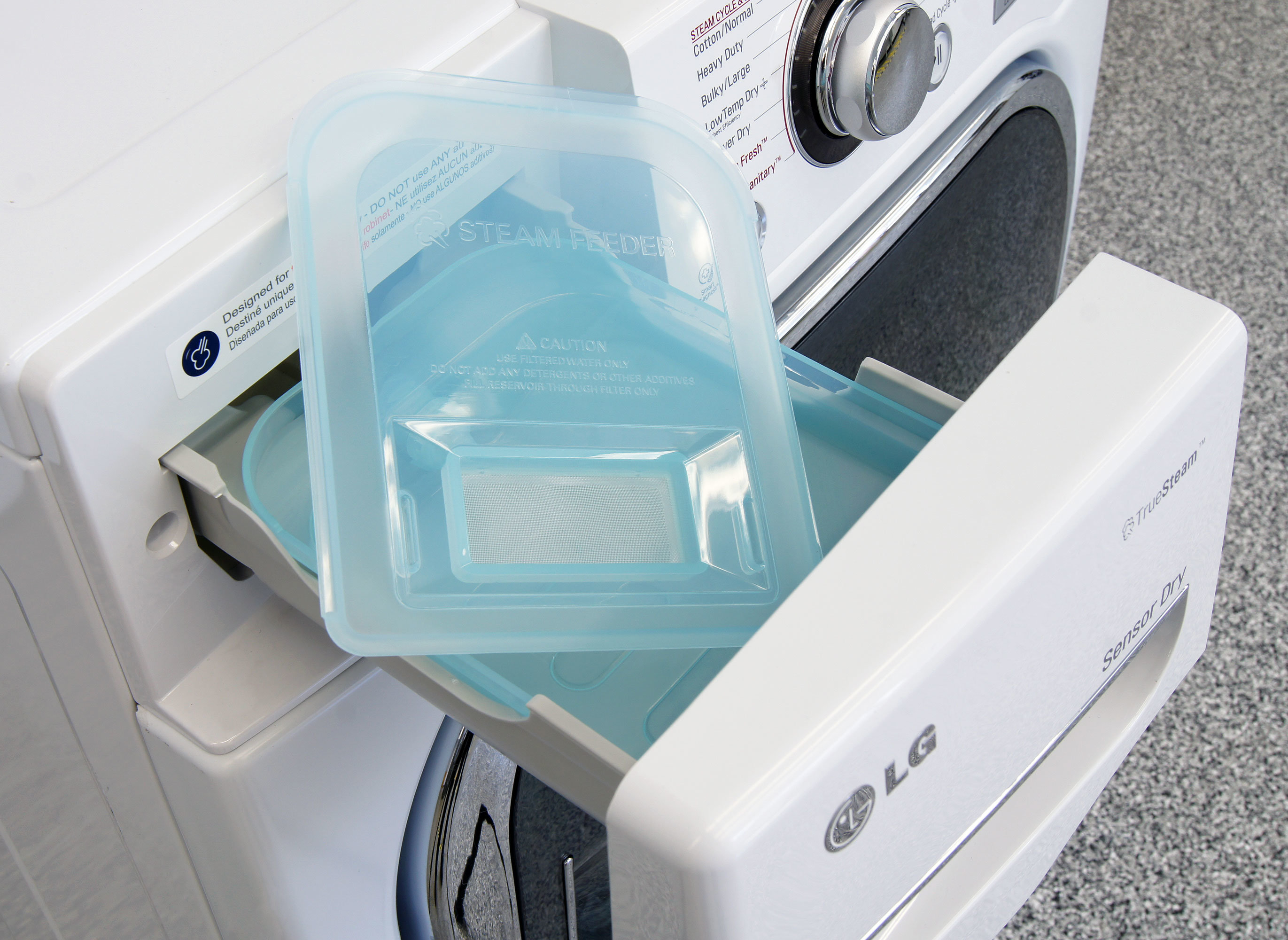 The lid pops off the bin for easy cleaning, but you're meant to pour water through the small filter to keep particulates out of the dryer.