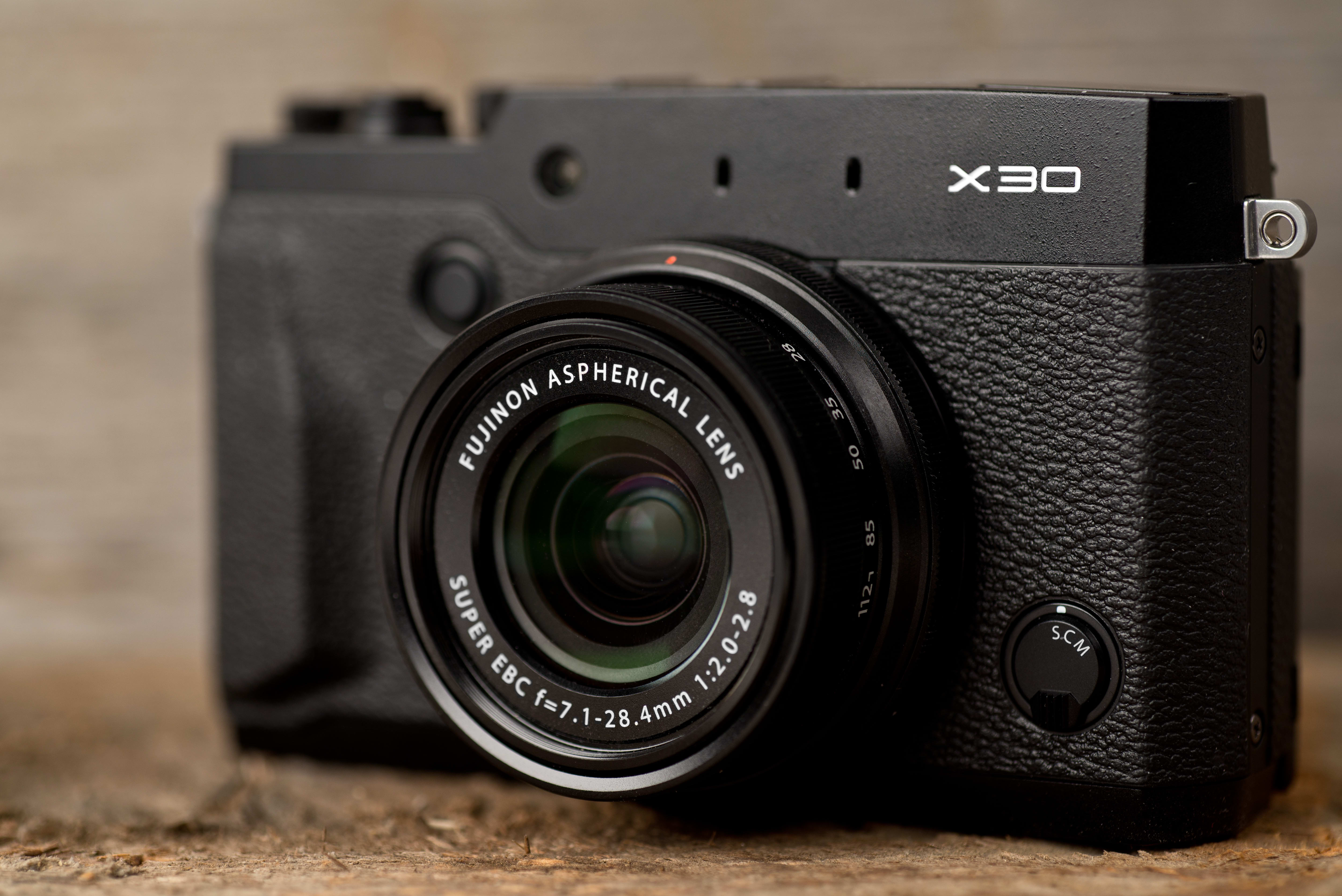 A photo of the Fujifilm X30's front face.