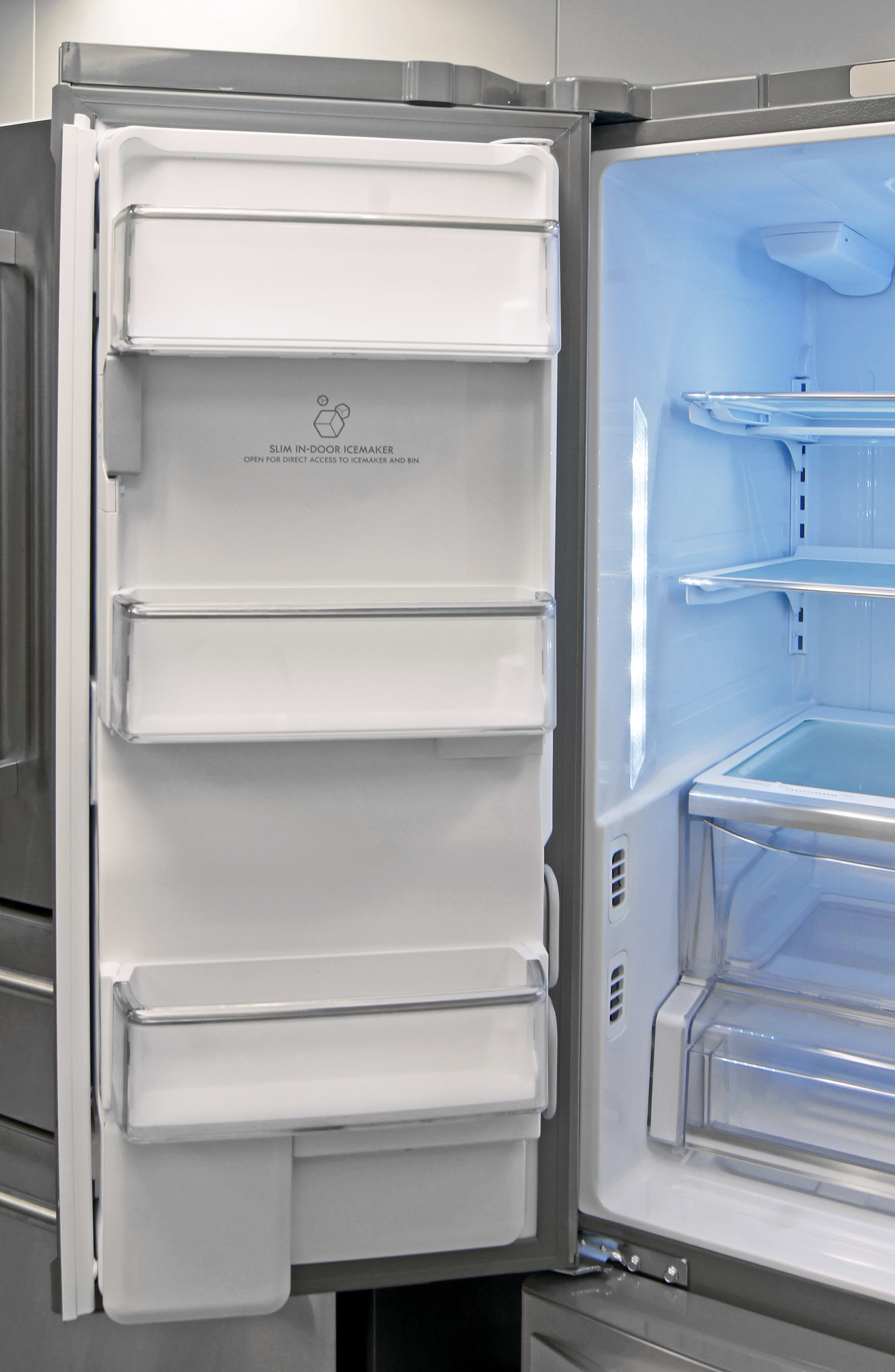 The Kenmore Elite 74025's slim icemaker keeps left door storage shallow, but still quite usable.