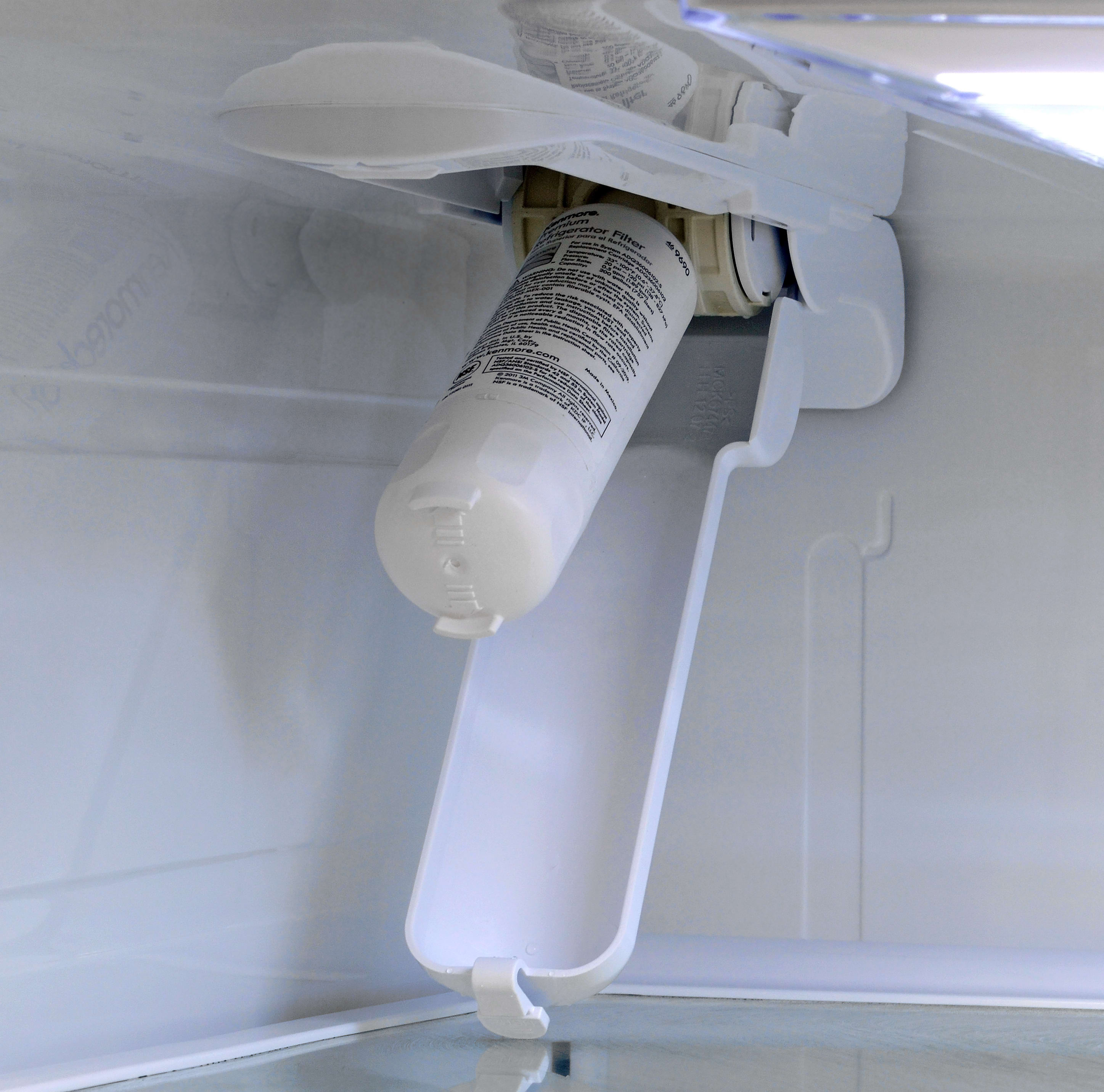 A partially recessed water filter is found in the top of the Kenmore 70333's main fridge compartment.