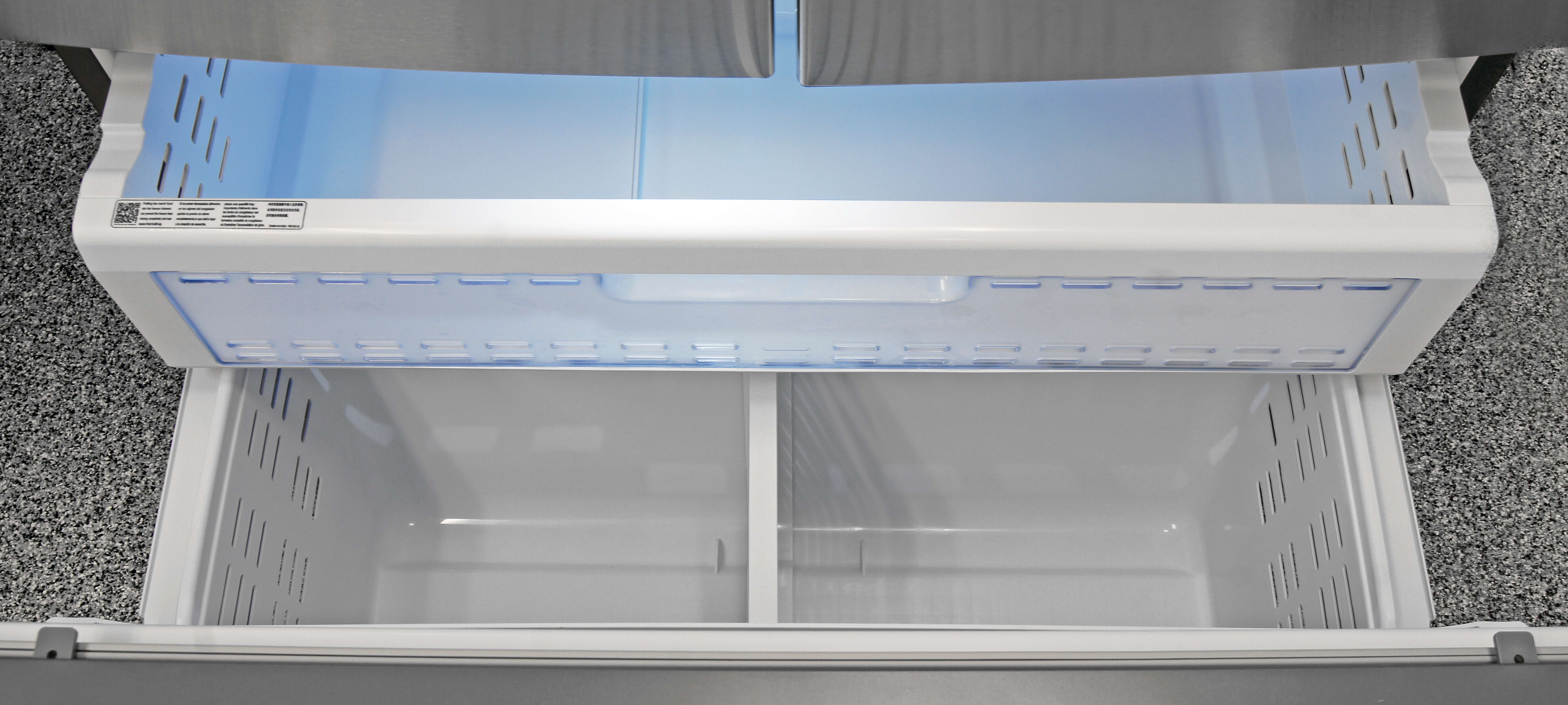 The Samsung RF23HTEDBSR's freezer has an upper and lower drawer, with an shallow shelf just inside the door.