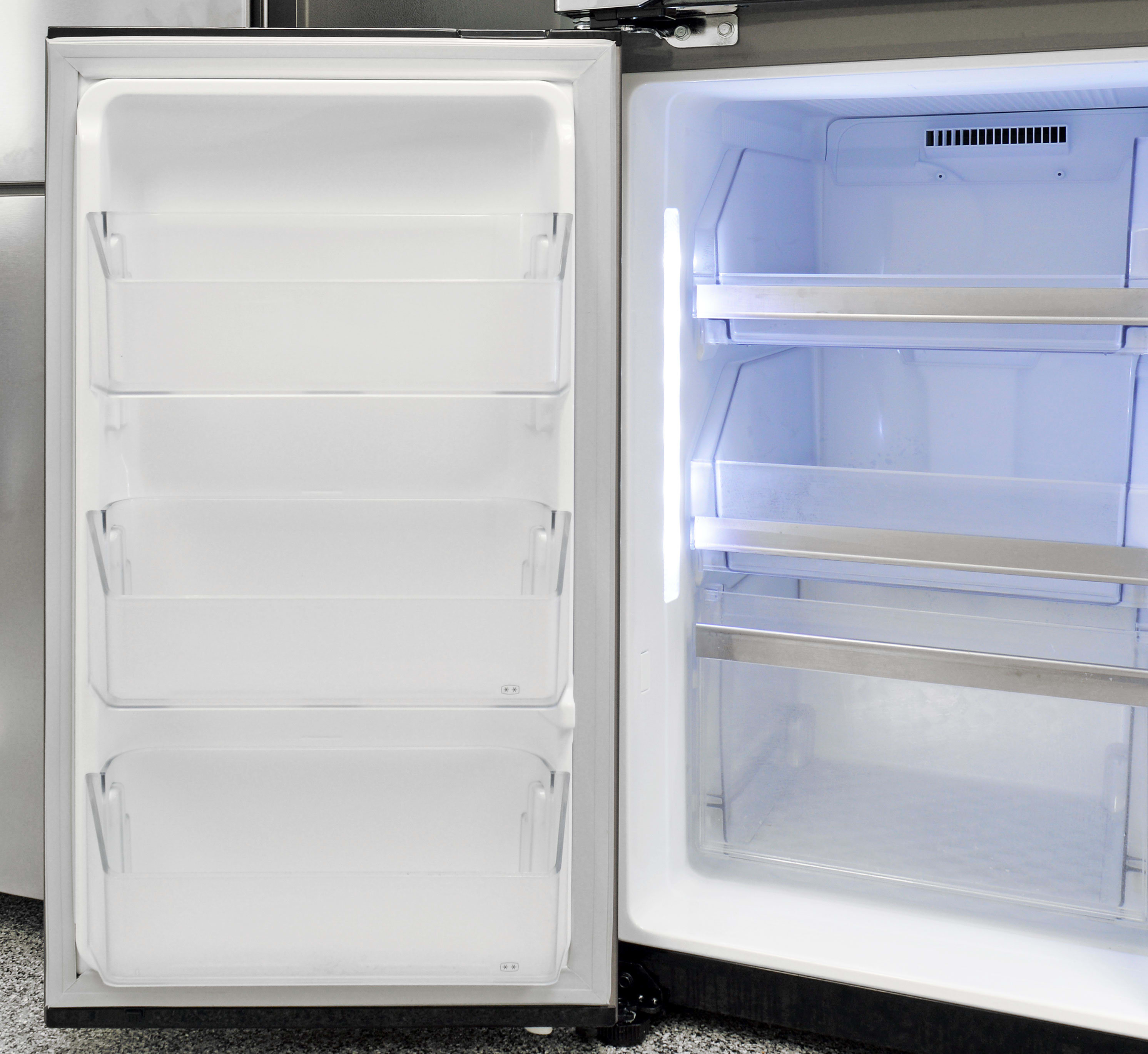Door storage in the LG LPXS30866D's freezer is composed of three shallow shelves that supplement the larger pullout drawers.