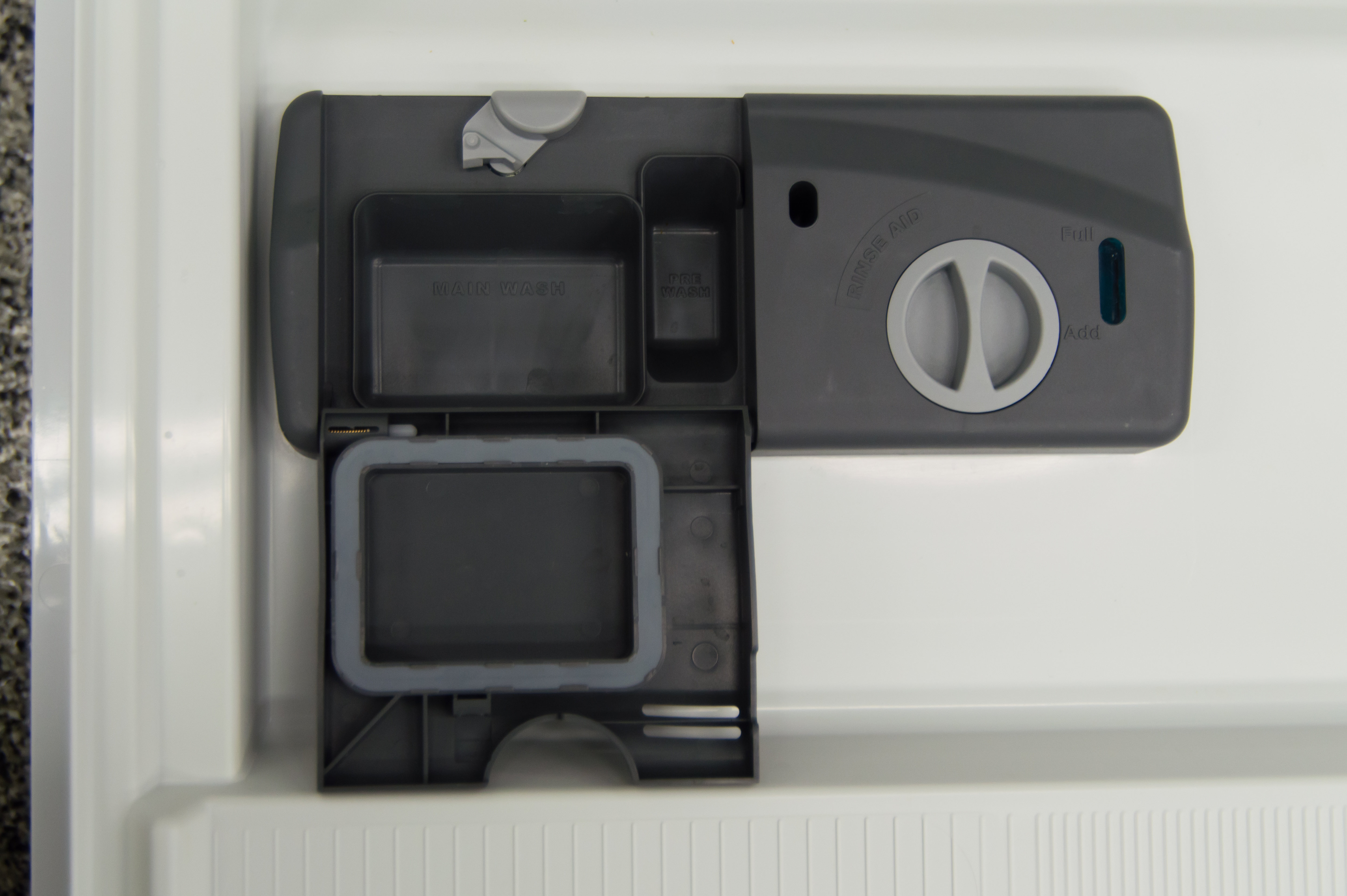 The detergent dispenser, with a separate pre-wash compartment, isn't marked for powder detergent.