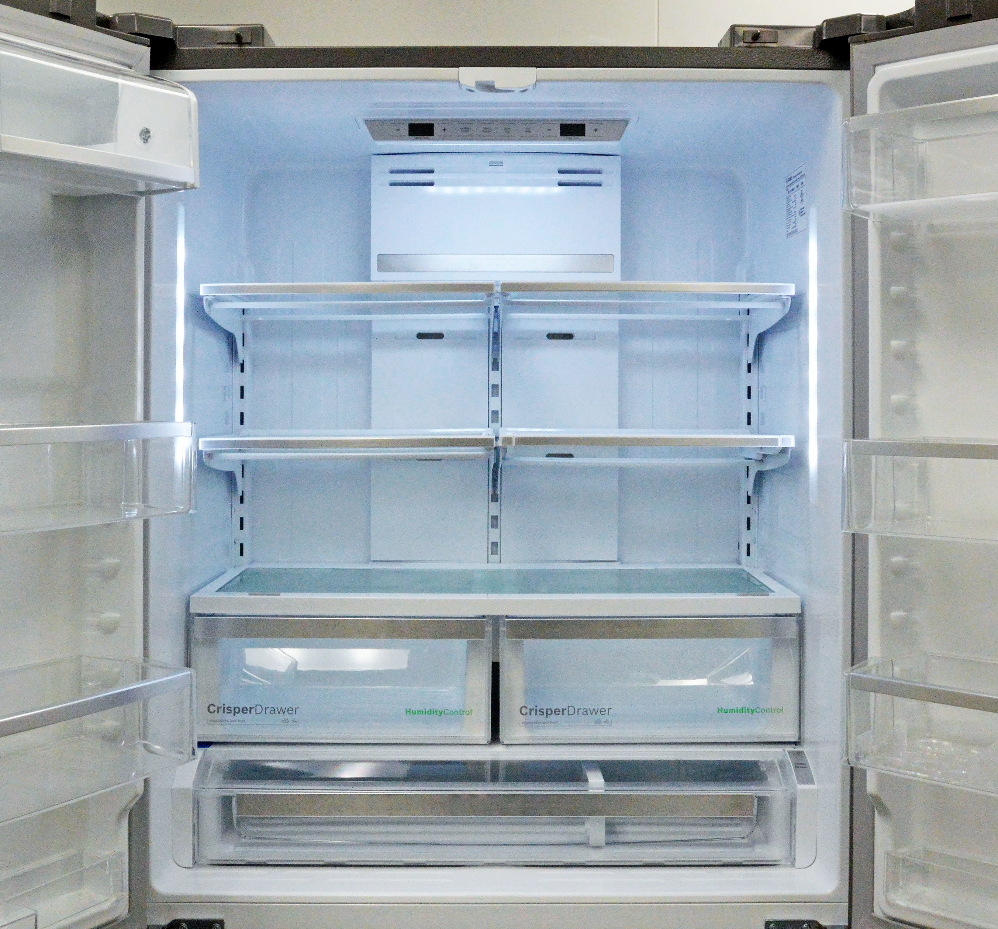 The fridge interior is well lit, but otherwise unremarkable. Note: in the 80SNS model, the control panel up top wouldn't be there.