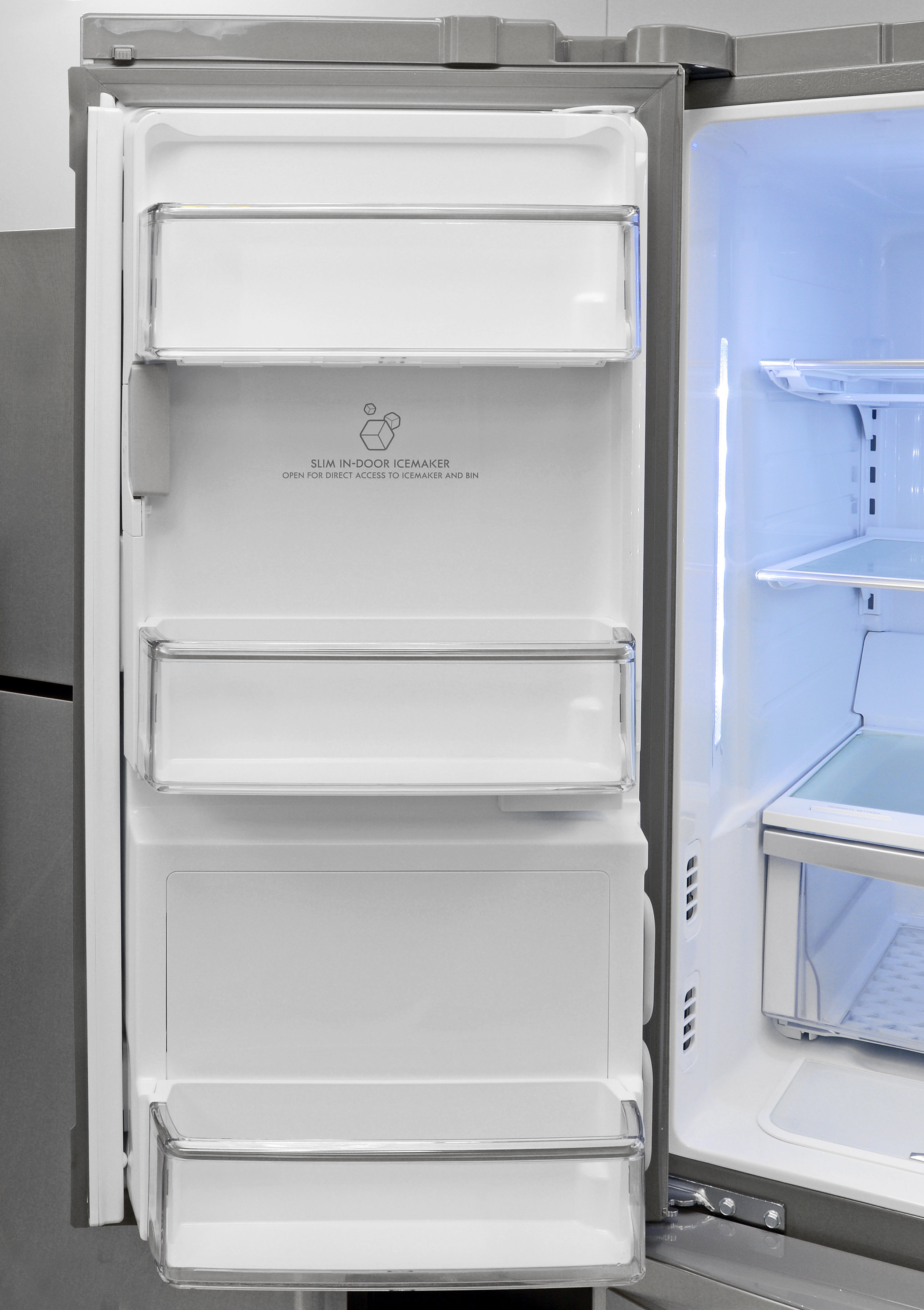 The Kenmore Elite 72483's left fridge door houses both the icemaker and the water filter.