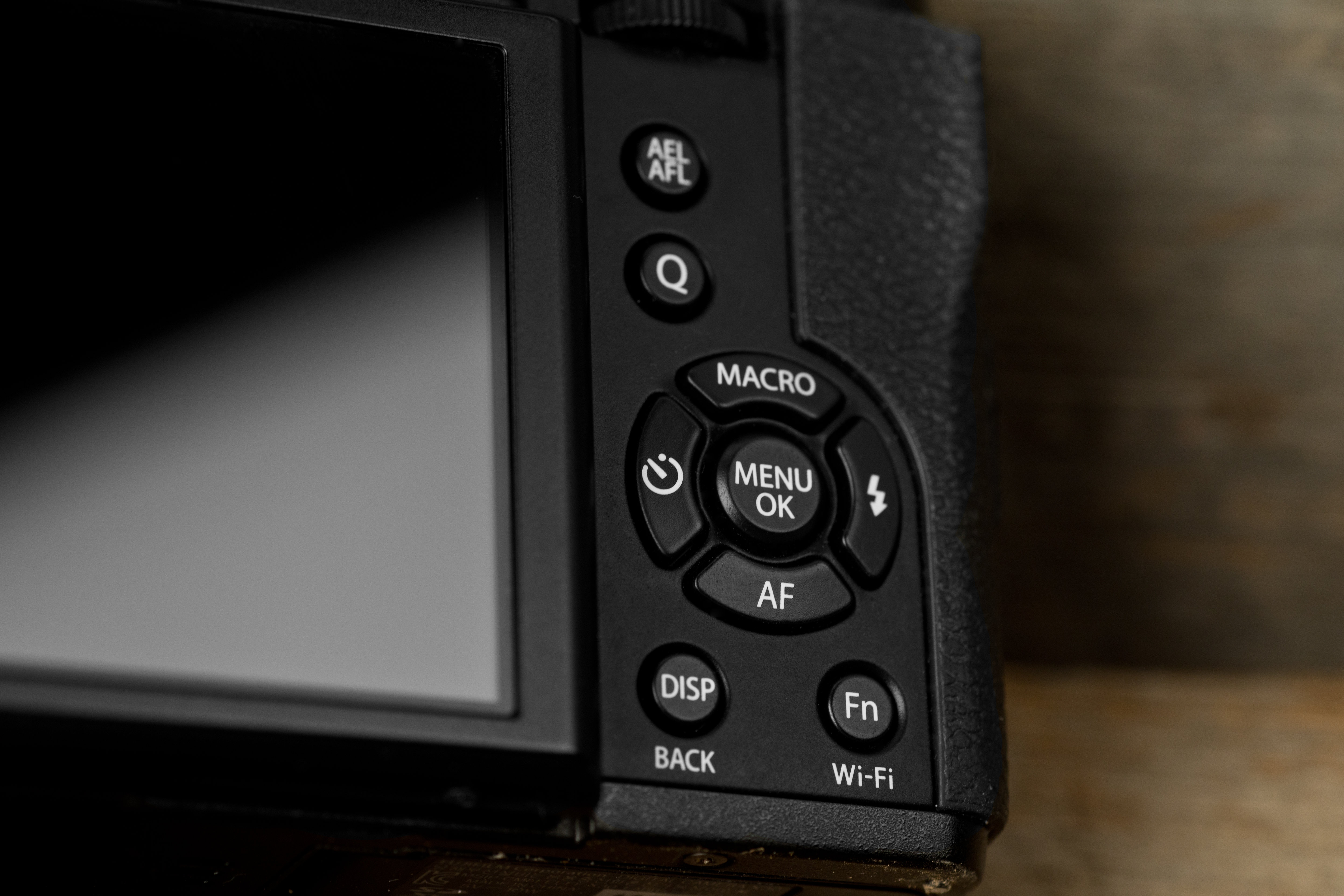 A photo of the Fujifilm X30's rear control cluster.