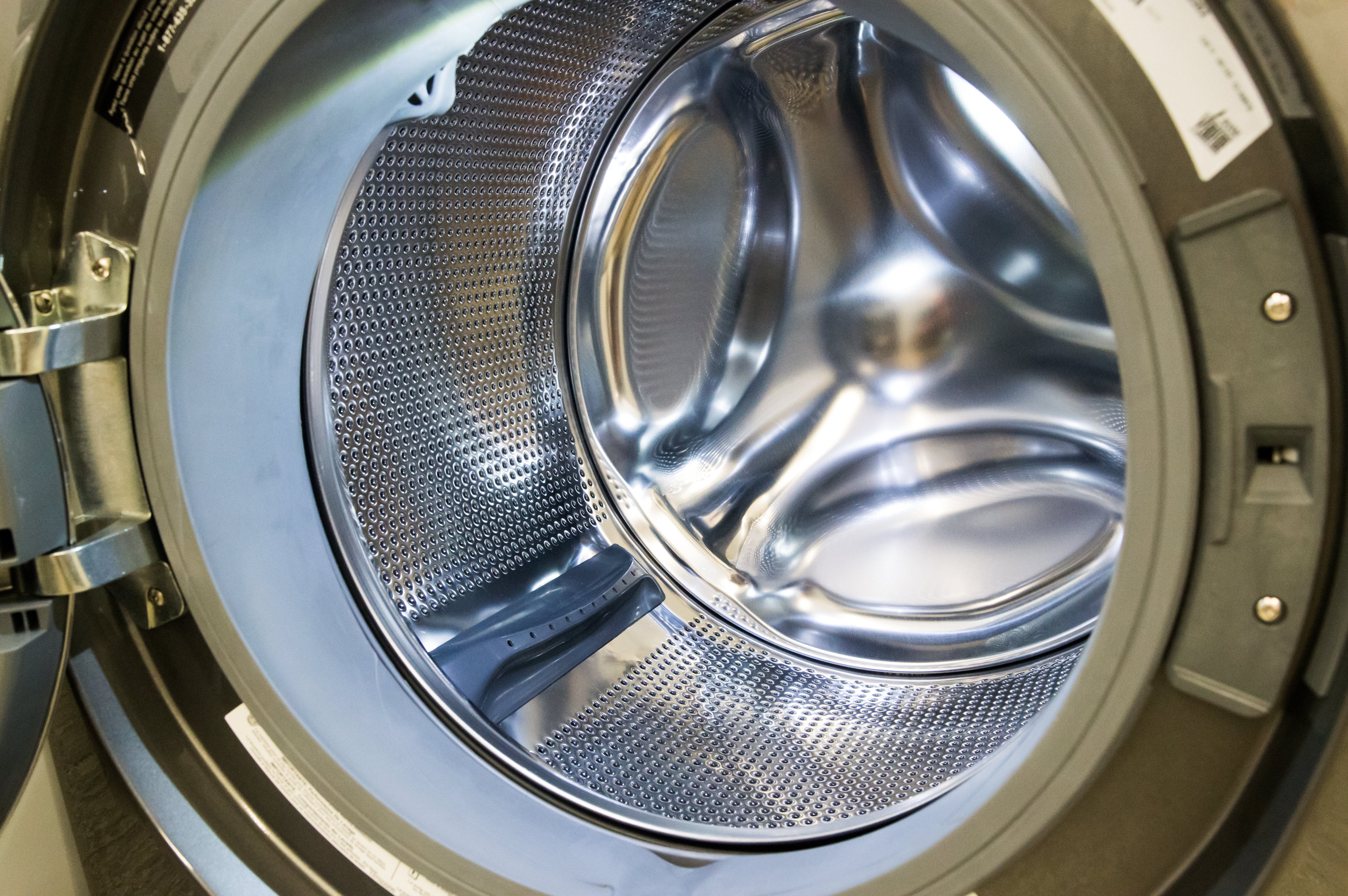 The beautiful stainless drum illuminated by interior lights.