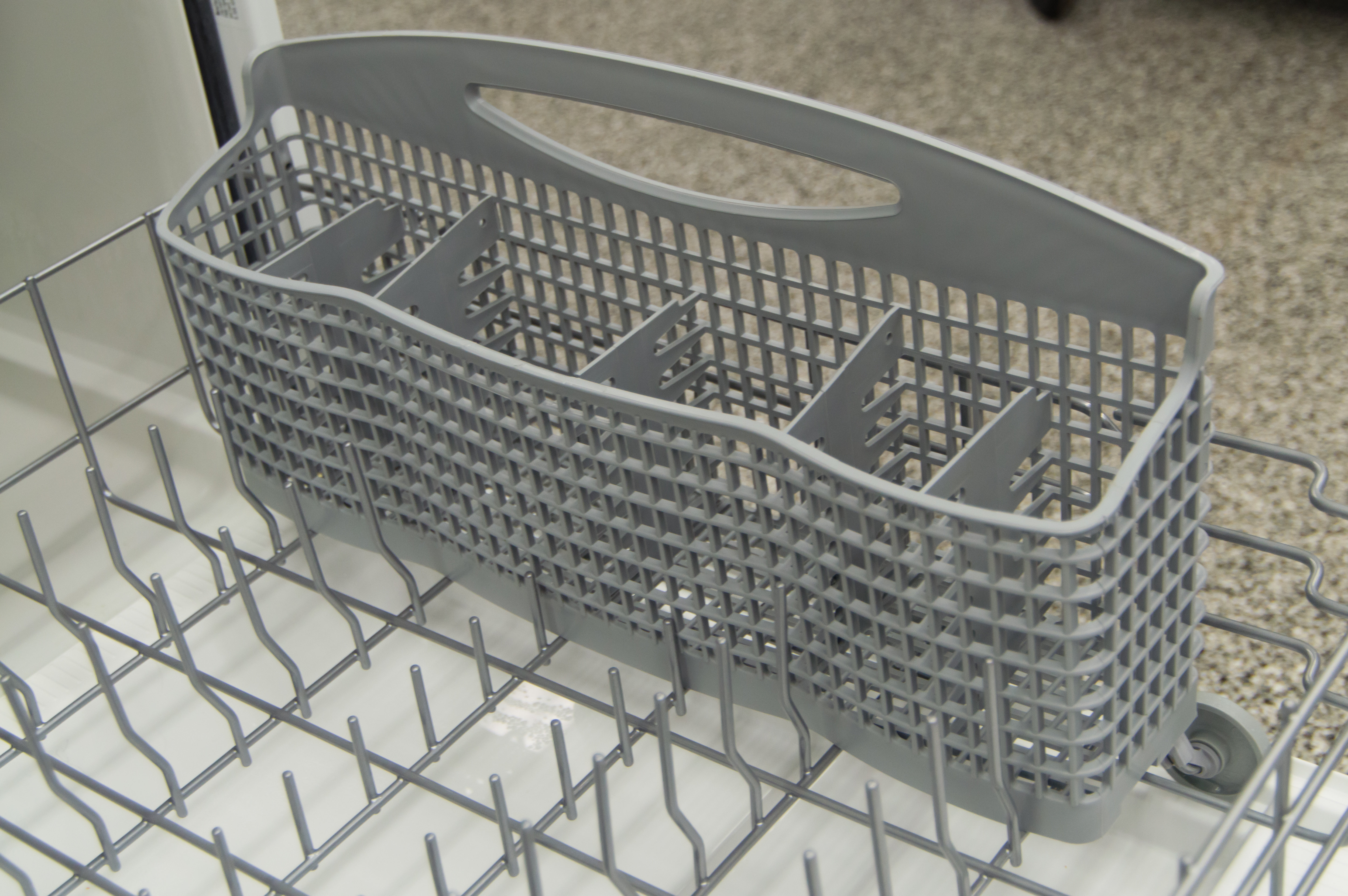 Nothing fancy about this cutlery basket, it doesn't split apart and there aren't any slots.