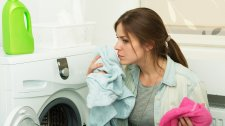 Why your washing machine smells%2c and how to clean it