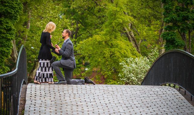Man proposing on bridge