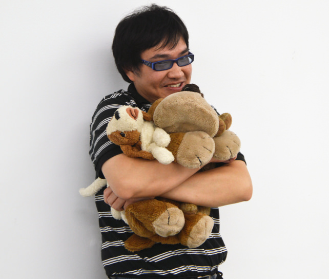 Man Hugging Stuffed Animals