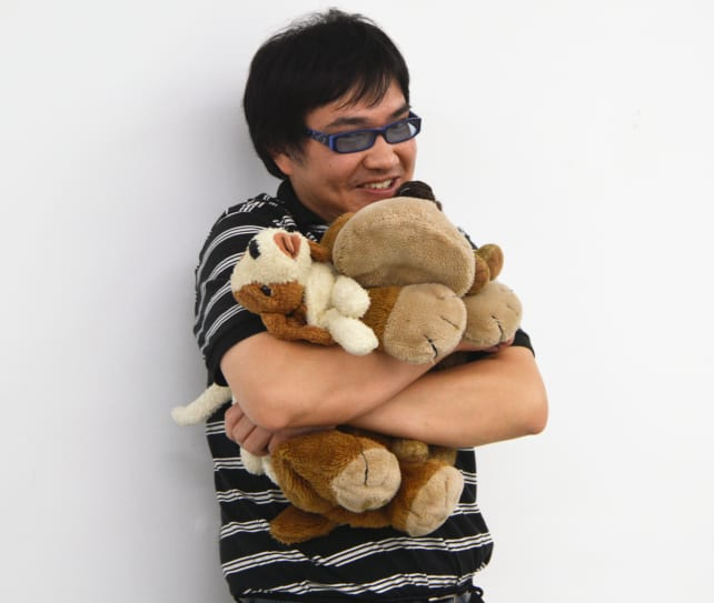 Man Hugging Stuffed Animals
