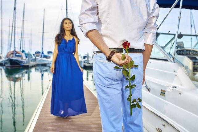 Man with rose proposing